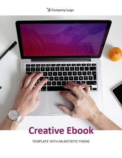 """example page from the artistic theme that reads """"creative ebook template with an artistic theme"""" in purple along with a dynamic photo of a laptop with purple screen"""